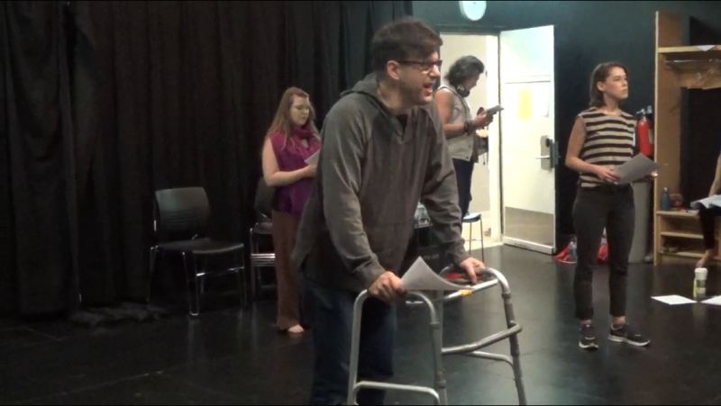The cast rehearsing for staged readings of Breaking Through