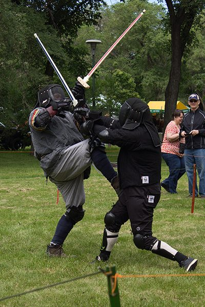 two men with swords engaged in mock combat