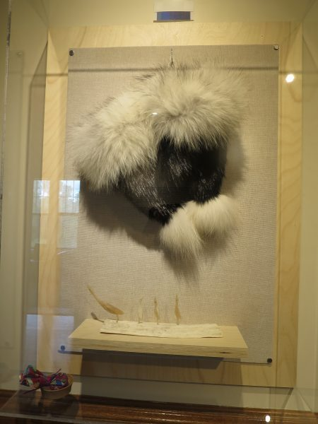 Rabbit and seal fur dancing drum mitts; bone and antler sculpture. /JOAN SUZUKI