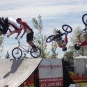 The four riders of the Wonder Wheels BMX Stunt Show simultaneously tumble through the air.