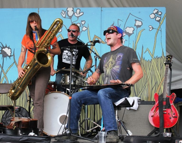 The Hooten Hollers from Columbia, Missouri rip into a tune with John Randall (guitar and vocals), Kellie Everett(bass and baritone saxophone) and Andy Rehm (drums and vocals). The party is on. /GREG PETZOLD