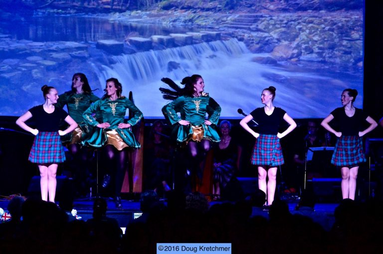 Irish dancers in green and Scottish dancers in plaid skirts
