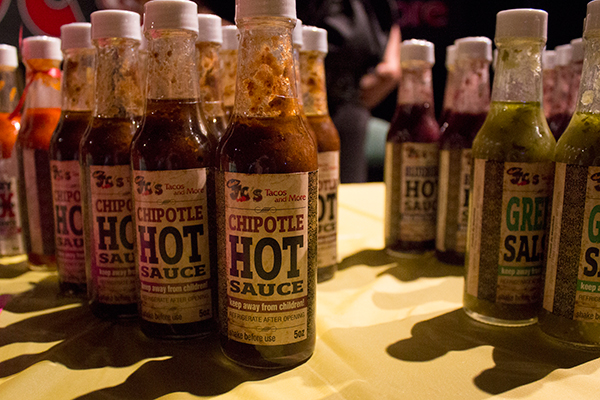 a close up of bottles of hot sauce