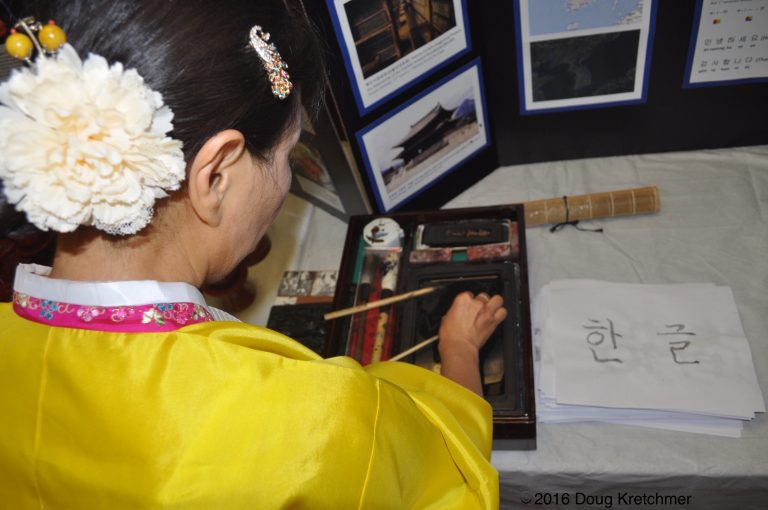 Youngok Kang-Bohr prepares the ink for calligraphy