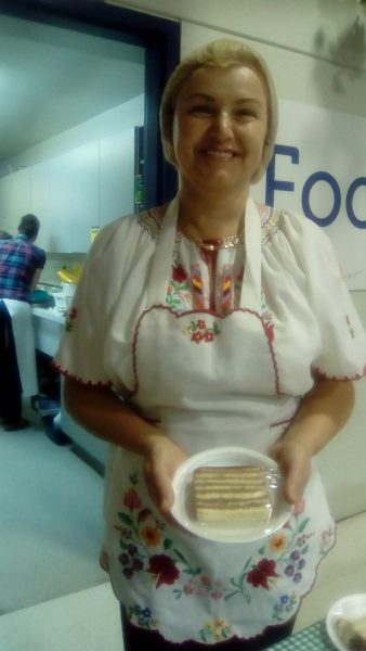Patricia Toth-Voros, dancer holding Langos or Bridget Peterson, one of many volunteers working the food Dovos
