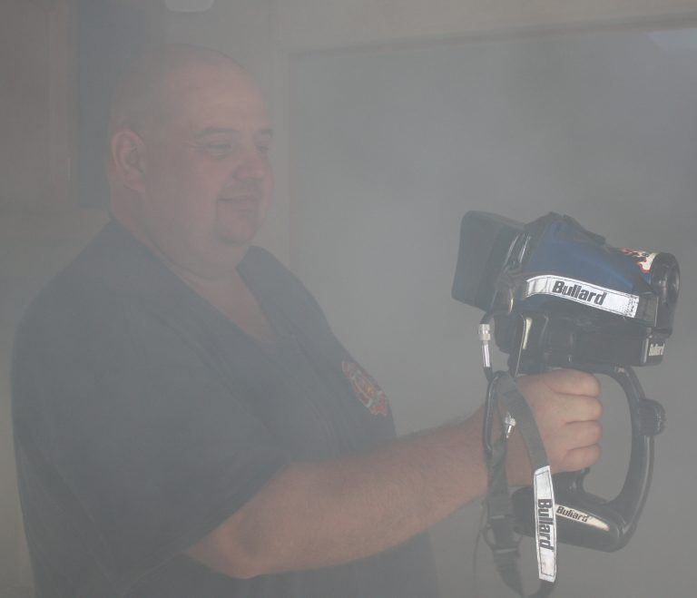 Wally Fey of the Selkirk Fire Department demonstrates teh thermal imaging camera through the smoky haze
