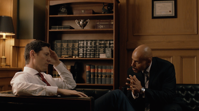 LtoR: Ari Cohen and Maurice Dean Wint in a scene from Shoot the Messenger.