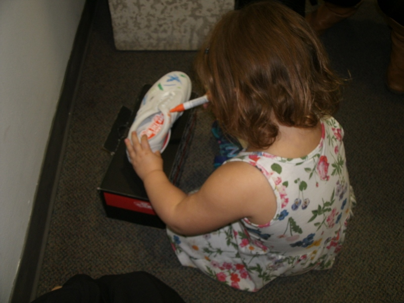 Shoe art making was an all ages activity. /ANNE HAWE