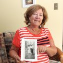 Glenda Dean displays a photo of her parents.