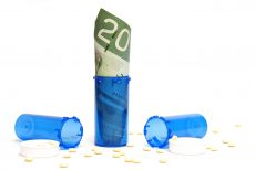 A conceptual shot of pills and money for anybody who feels the effects of prescription costs.
