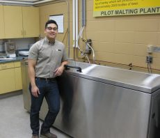 Micro-biologist Aaron Onio oversees the malting and brewing plant