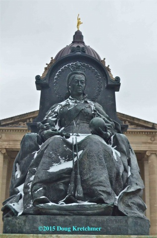 Snow in May on Queen Victoria statue at the Legislature - Happy Victoria Day <br /><em> by Doug Kretchmer </em>