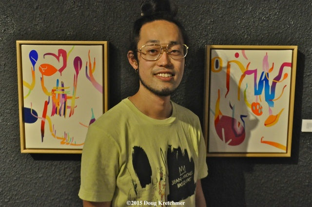 Artist Takashi Iwasaki's opening reception was at Fleet Galleries on Friday night. His art work will be exhibited along with Josh Kerschtein's art til July 16. PHOTO by Doug Kretchmer