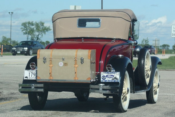 """Cool old 1931 Ford cruising down Trans Canada Highway with awesome """"trunk"""" at the back. PHOTO by Suzanne Hunter"""
