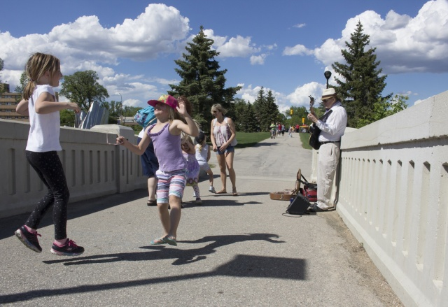 Tim Butler's music gets the kids hopping at Assiniboine Park. PHOTO by Marie LeBlanc