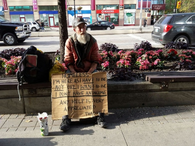 """Kirk says he has been forced into homelessness while he waits several weeks for an appointment with welfare. """"The whole system needs to be redone,"""" he says. PHOTO by Marie LeBlanc"""