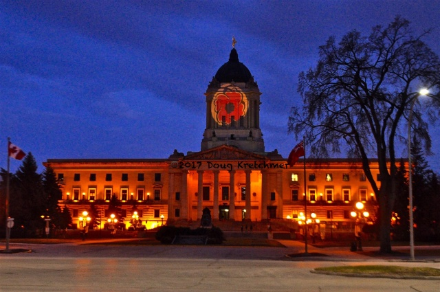 The Legislative building at dusk on Good Friday. PHOTO by Doug Kretchmer