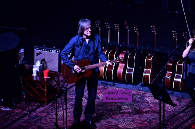 """Jackson Browne brought a collection of guitars and a piano to The Burt last night. He was accompanied by Sara (violin & vocals) and Sean Watson (acoustic guitar & vocals). The singer-songwriter shared great songs and interesting stories (and even played a couple requests because, """"It's easier that way."""") PHOTO by Doug Kretchmer"""