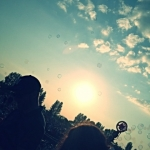 Bubbles in the sunset at 40th Winnipeg Folk Festival's opening night.<br /><em>Submitted by Bee Erenberg</em>