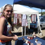 Debating over flavoured honey options at Pine Ridge Hollow Farmer's Market.<br /><em>Submitted by Jenna Friesen</em>