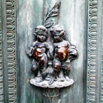 Cherubs on doors of Millennium Centre.<br /><em>Submitted by Greg Petzold</em>