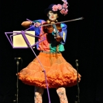 Bernadette The Clown tries her hand at the viola.<br /><em>Submitted by Doug Kretchmer</em>