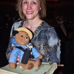 Conductor Michelle Mourre with Paddington Bear and The Gondoliers score by Gilbert & Sullivan.<br /><em>Submitted by Doug Kretchmer</em>